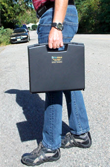 QuFlexx Briefcase holding in hand